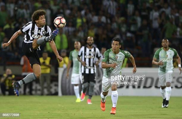 Brazil's Botafogo player Fernando Camilo vies for the ball with Colombia's Atletico Nacional player Diego Arias during their 2017 Copa Libertadores...