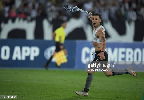 Brazil's Botafogo player Leo Valencia celebrates after scoring against Parguay's Nacional during their Copa Sudamericana football match at the...