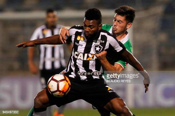 Brazil's Botafogo player Marcelo vies for the ball with Chile's Audax Italiano player Sebastian Diaz during their Copa Sudamericana football match at...