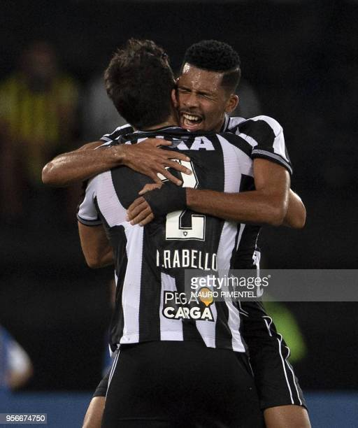 Brazil's Botafogo player Matheus Fernandes celebrates with a teammate after scoring a goal during a Copa Sudamericana 2018 football match against...