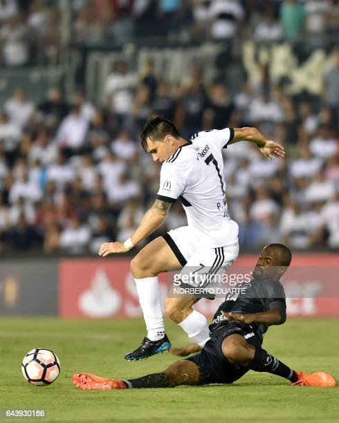 Brazil's Botafogo player Matheus Fernandes vies for the ball with Paraguay's Olimpia player Pablo Mouche during their Copa Libertadores 2017 football...
