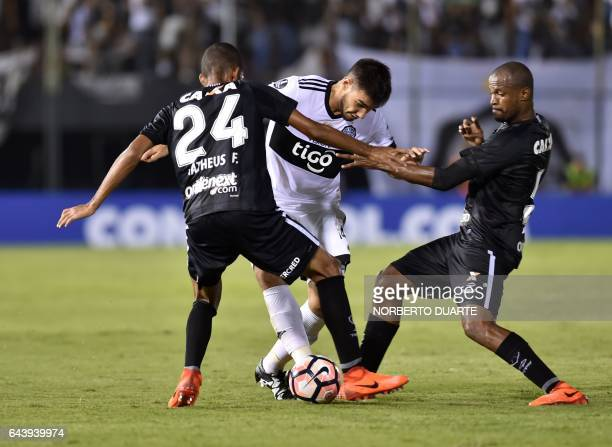 Brazil's Botafogo player Matheus Fernandes vies for the ball with Paraguay's Olimpia player Jose Canete during their Copa Libertadores 2017 football...