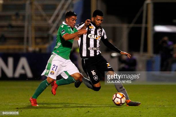 Brazil's Botafogo player Matheus Fernandes vies for the ball with Chile's Audax Italiano player Luis Cabrera during their Copa Sudamericana football...