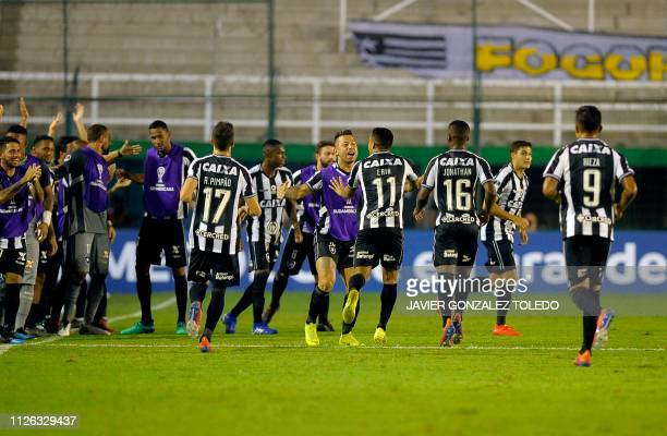 Brazil's Botafogo players celebrate after scoring against Argentina's Defensa y Justiciaduring a Copa Sudamericana first round second leg football...