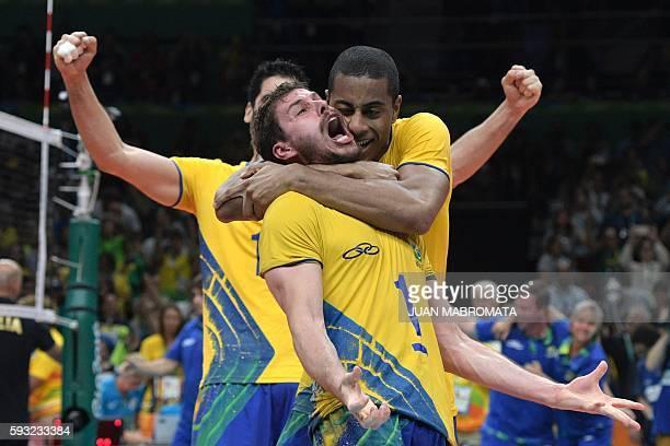 Brazil's Bruno Mossa De Rezende reacts after winning the men's Gold Medal volleyball match against Italy at the Maracanazinho stadium in Rio de...