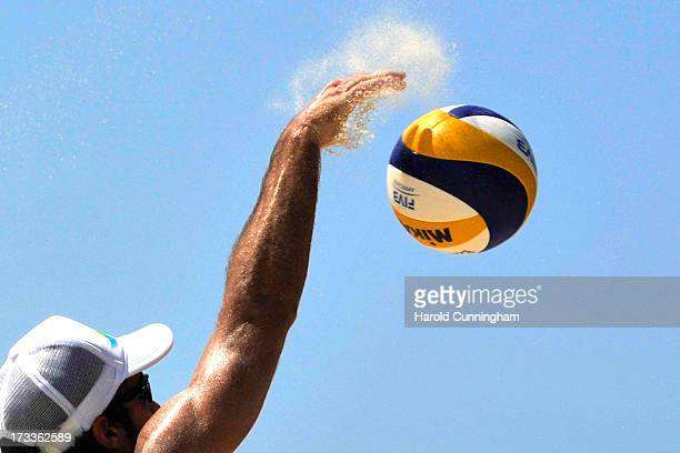 Brazil's Bruno Oscar Schmidt attacks during the Schmidt PedroBruno v SidorenkoDyachenko game as part of the FIVB Gstaad Grand Slam fourth day on July...