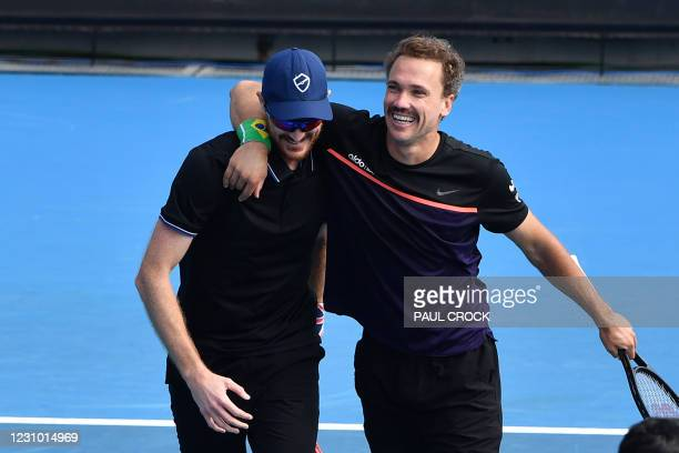 Brazil's Bruno Soares and Britain's Jamie Murray react after winning against Colombia's Juan Sebastian Cabal and Robert Farah during their Great...