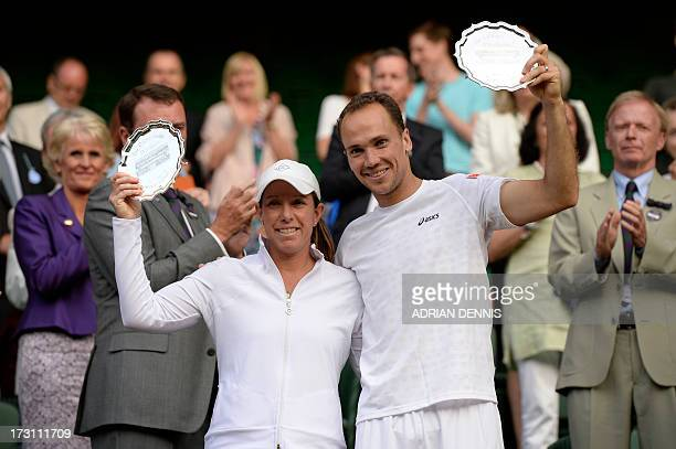Brazil's Bruno Soares and US player Lisa Raymond pose with their runners up plates after losing the mixed doubles final to Canada's Daniel Nestor and...