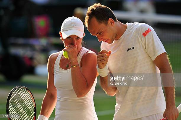 Brazil's Bruno Soares and US player Lisa Raymond talk between points against Canada's Daniel Nestor and France's Kristina Mladenovic in the mixed...