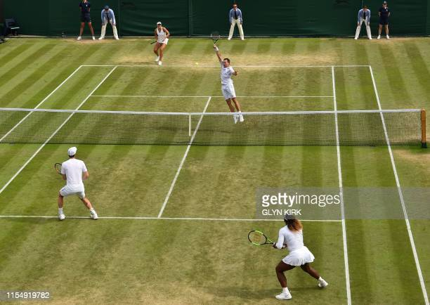 Brazil's Bruno Soares and US player Nicole Melichar return against Britain's Andy Murray and US player Serena Williams during their mixed doubles...