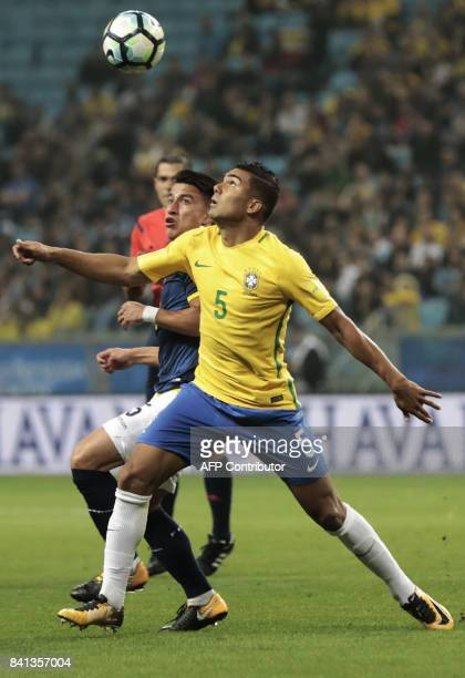 Brazil's Casemiro and Ecuador's Fernando Gaibor vie for the ball during their 2018 World Cup qualifier football match in Porto Alegre Brazil on...