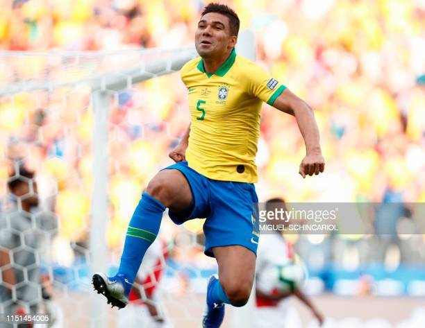 Brazil's Casemiro celebrates after scoring against Peru during their Copa America football tournament group match at the Corinthians Arena in Sao...