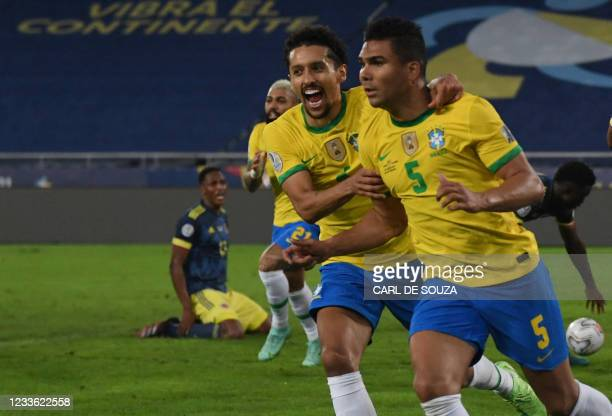 Brazil's Casemiro celebrates with teamamte Marquinhos after scoring against Colombia during the Conmebol Copa America 2021 football tournament group...