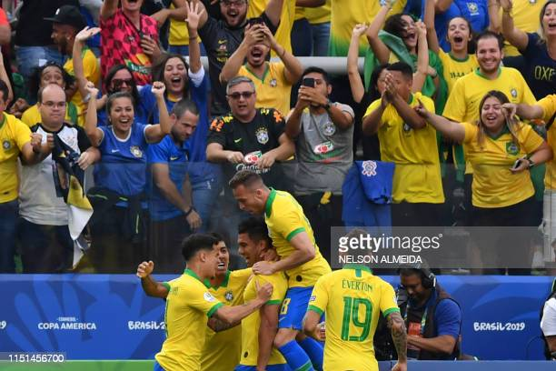 Brazil's Casemiro celebrates with teammates after scoring against Peru during their Copa America football tournament group match at the Corinthians...