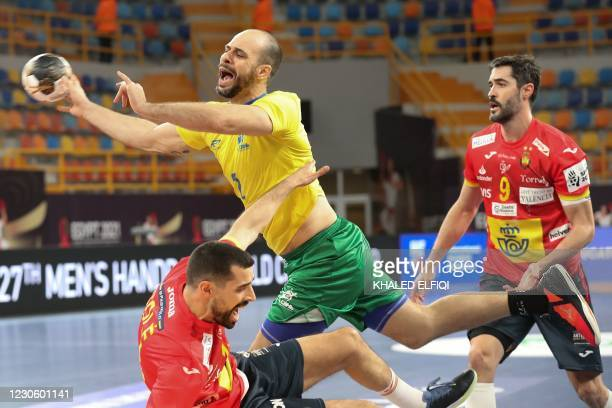 Brazil's centre back Henrique Teixeira is challenged by Spain's right winger Ferran Sole during the 2021 World Men's Handball Championship match...