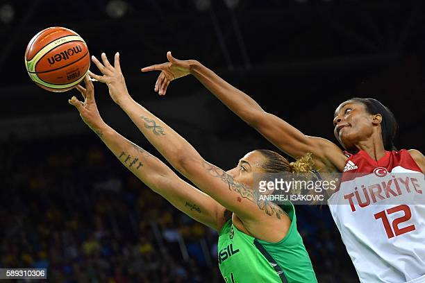 TOPSHOT Brazil's centre Erika Souza goes to the basket past Turkey's centre Lara Sanders during a Women's round Group A basketball match between...