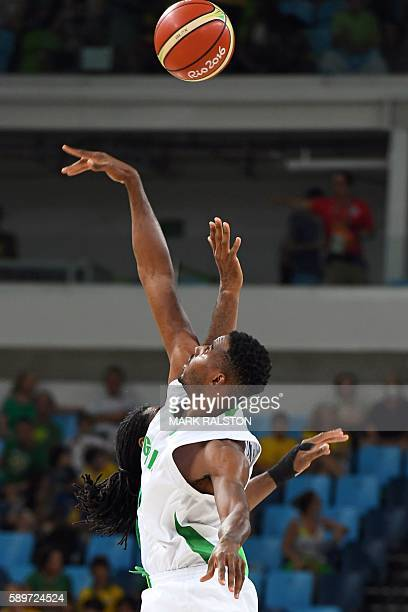 Brazil's centre Nene Hilario and Nigeria's power forward Alade Aminu jump for the ball at the start of a Men's round Group B basketball match between...