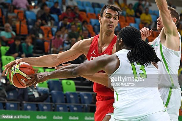 TOPSHOT Brazil's centre Nene Hilario holds off Croatia's forward Dario Saric during a Men's round Group B basketball match between Brazil and Croatia...