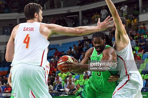TOPSHOT Brazil's centre Nene Hilario makes his way through Spain's centre Pau Gasol and Spain's power forward Nikola Mirotic during a Men's round...