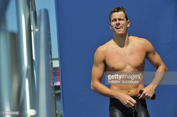 Brazil's Cesar Cielo Filho gets out of the pool after the men's 50m freestyle at the 7th edition of the Open de France in BellerivesurAllier on July...