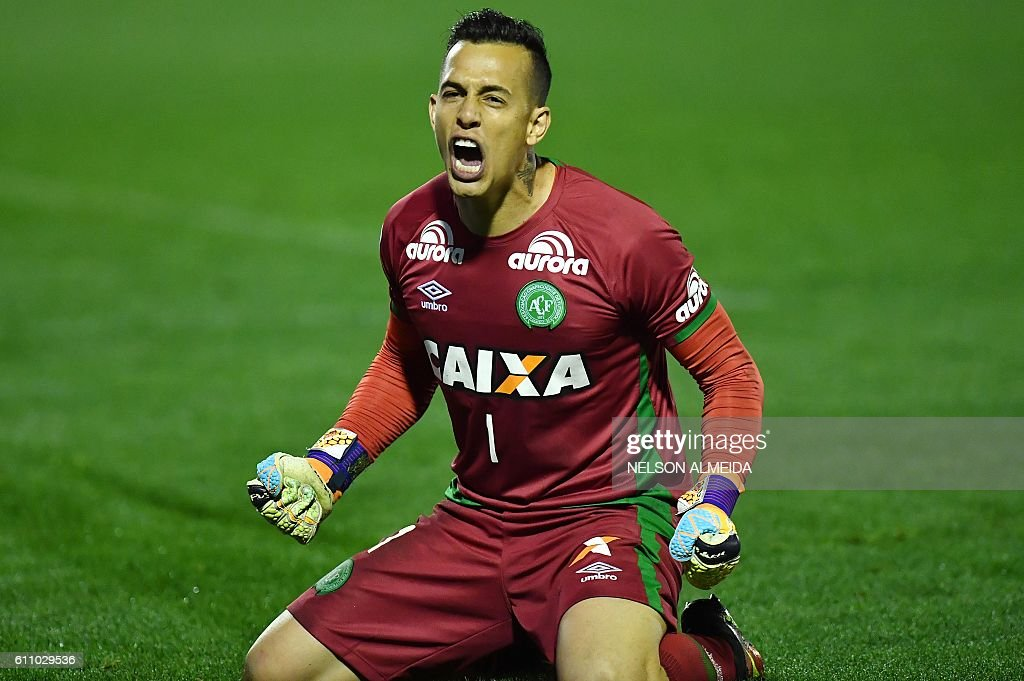 Brazil's Chapecoense goalkeeper Danilo celebrates after defeating Argentina's Independiente in a penalty shoot-out during their Sudamericana Cup match at the Arena Conda stadium, in Chapeco, Brazil, on September 28, 2016. / AFP / NELSON