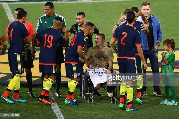 Brazil's Chapecoense goalkeeper Jackson Follmann a survivor of the LaMia air crash in Colombia receives a tribute from the Colombian team during a...