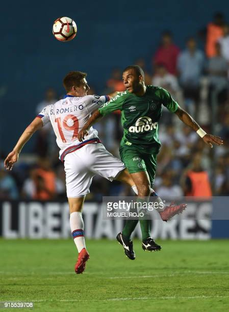 Brazil's Chapecoense player Amaral vies for the ball with Uruguay's Nacional player Santiago Romero during their Libertadores Cup football match at...