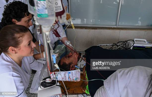 TOPSHOT Brazil's Chapecoense player Helio Neto is helped by paramedics at the San Juan de Dios clinic in La Ceja Antioquia Department on November 29...
