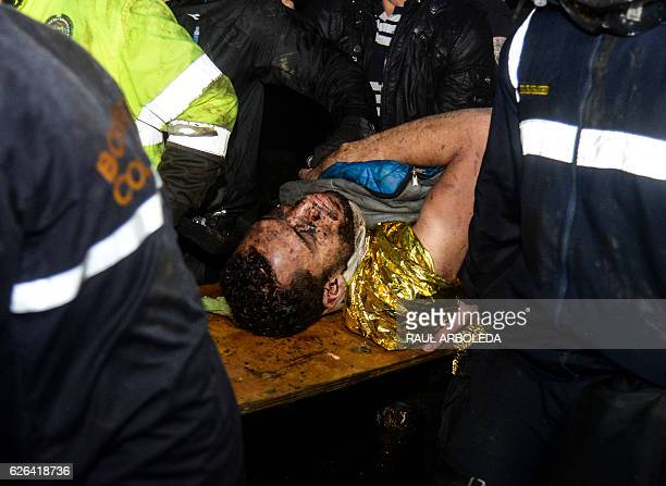 TOPSHOT Brazil's Chapecoense player Helio Neto is helped by paramedics in la Union Antioquia Department on November 29 2016 after being rescued from...