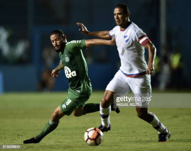 Brazil's Chapecoense player Nenem vies for the ball with Uruguay's Nacional player Diego Arismendi during their Libertadores Cup football match at...