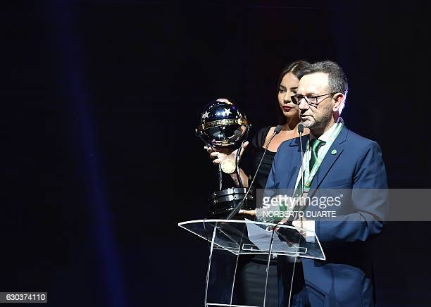 Brazil's Chapecoense Real club Plinio David holding the Copa Sudamericana trophy delivers a speech during the Libertadores Cup draw in Luque Paraguay...