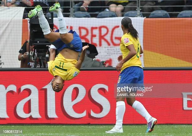 Brazil's Christiane celebrates scoring Brazil's second goal with teammate defender Rosana during the Guinea vs Brazil Group D match of the FIFA...