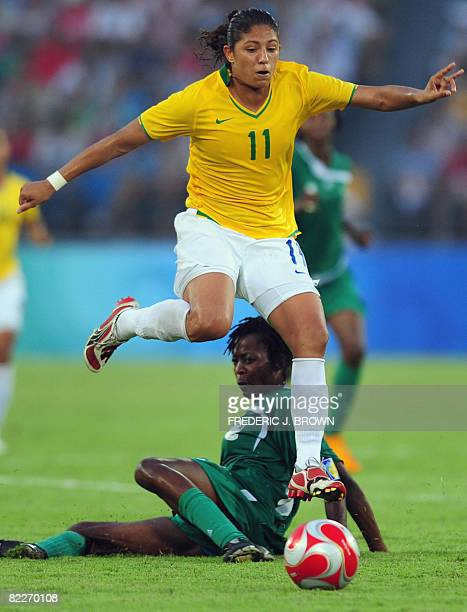 Brazil's Christiane leaps over Nigeria's Christie George in their women's first round group F football match at the Beijing 2008 Olympic Games on...