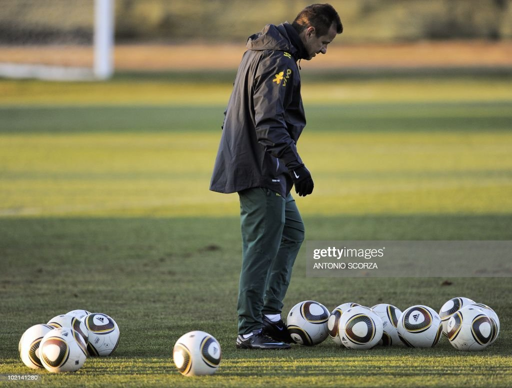 Brazil's coach Dunga kicks somes balls during a team training session at Randburg High School on June 16, 2010 in Johannesburg as they team prepares to face the Ivory Coast on June 20 in their second opening round match at the 2010 World Cup in South Africa.