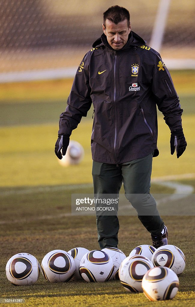 Brazil's coach Dunga kicks somes balls during a team training session at Randburg High School on June 16, 2010 in Johannesburg as they team prepares to face the Ivory Coast on June 20 in their second opening round match at the 2010 World Cup football tournament in South Africa.