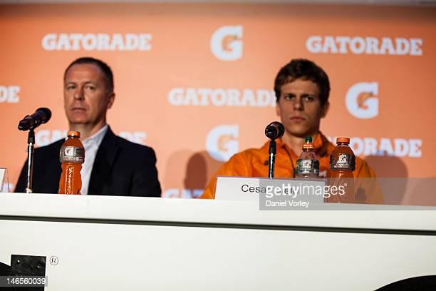 Brazil's Coach Mano Menezes and Brazilian swimmer Cesar Cielo speak at a Press conference organized by Gatorade in Pacaembu Stadium on June 19, 2012...