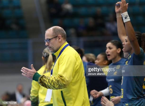 Brazil's coach Morten Soubak gives instructions during the women's handball match between Germany and Brazil in Kolding Denmark 8 December 2015 PHOTO...