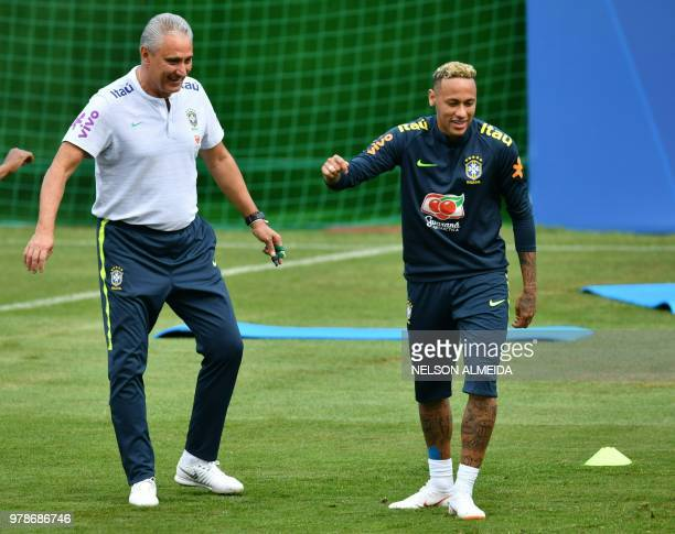 Brazil's coach Tite and Brazil's forward Neymar are seen during a training session of Brazil national football team at Yug Sport Stadium in Sochi on...