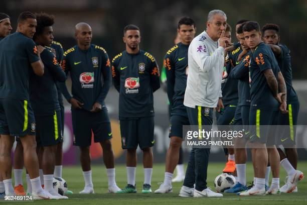 Brazil's coach Tite gestures during a training session of the national football team ahead of the FIFA 2018 World Cup at Granja Comary training...