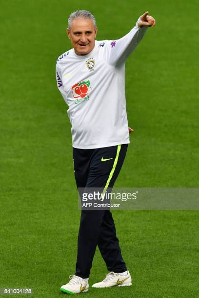 Brazil's coach Tite gestures during a training session on the eve of their 2018 FIFA Russia World Cup qualifier football match against Ecuador at the...