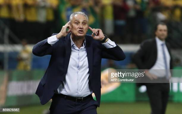 Brazil's coach Tite gestures during their FIFA 2018 World Cup qualifier football match against Chile in Sao Paulo Brazil on October 10 2017 / AFP...