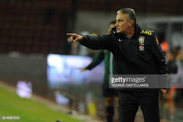 Brazil's coach Tite gestures during their Russia 2018 World Cup football qualifier match against Venezuela in Merida Venezuela on October 11 2016 /...