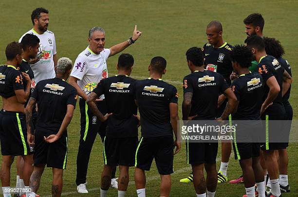 Brazil's coach Tite gives instructions to the players during a training session on September 5 2016 at the Arena Amazonia stadium in Manaus Brazil on...