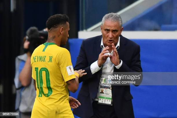 Brazil's coach Tite talks to Brazil's forward Neymar during the Russia 2018 World Cup round of 16 football match between Brazil and Mexico at the...