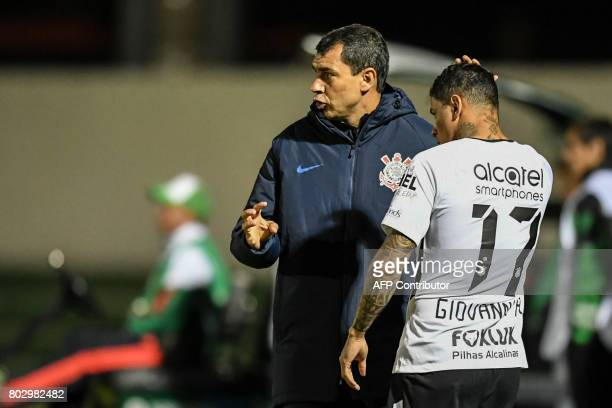 Brazil's Corinthians coach Fabio Carille gives instructions to his midfielder Giovanni Augusto during their Copa Sudamericana football match against...