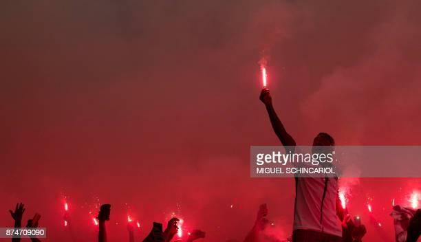 TOPSHOT Brazil's Corinthians fans cheer during their 2017 Brazilian championship football match against Brazil's Fluminense at the Arena Corinthians...
