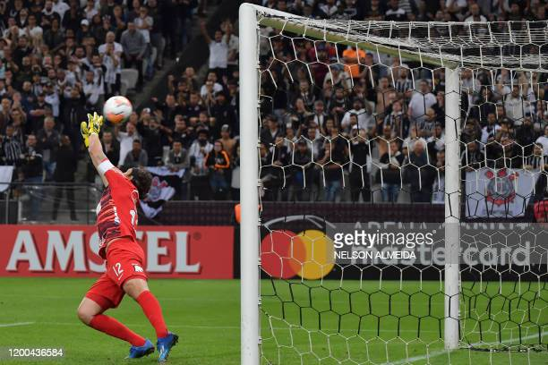 Brazil's Corinthians goalkeeper Cassio jumps but fails to stop the ball shot by Paraguay's Guarani Fernando Fernandez during their 2020 Copa...