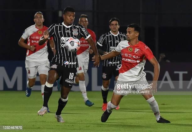 Brazil's Corinthians Leo Natel and Paraguay's River Plate Rodrigo Vera vie for the ball during their Copa Sudamericana football tournament group...