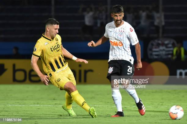 Brazil's Corinthians player Camacho vies for the ball with Paraguay's Guarani player Jorge Morel during their Copa Libertadores football match at...