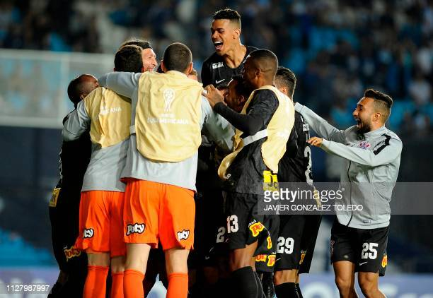 Brazil's Corinthians players celebrate after a Copa Sudamericana first round second leg football match against Argentina's Racing Club at Presidente...